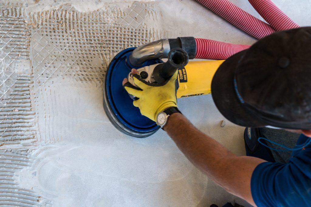 man removing floors dust free